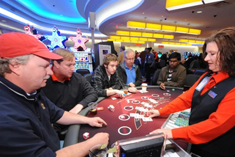 Michael Lee (left), 49, and his buddy Johnny Mac, 47, both from Wayne, play blackjack at a $15 minimum table at the newly opened Valley Forge Casino Resort at the Valley Forge Convention Center in King of Prussia Saturday, March 31, 2012.  ( Clem Murray / Staff Photographer )