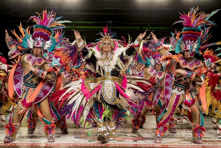 """Downtowners' Captain Anthony Stagliano, center, dances the middle of his brigade as they perform """"Rio Festival of Animals."""""""