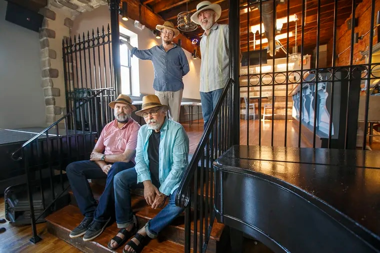 The people from the Tin Angel, seated left to right, Donal McCoy, and Richard Kardon and standing left to right, Jessie Lundy and Lawrence Goldfarb, are opening a new music club in Manayunk called the Locks at Sona , on the second floor of the Irish bar Sona on Main Street. MICHAEL BRYANT / Staff Photographer