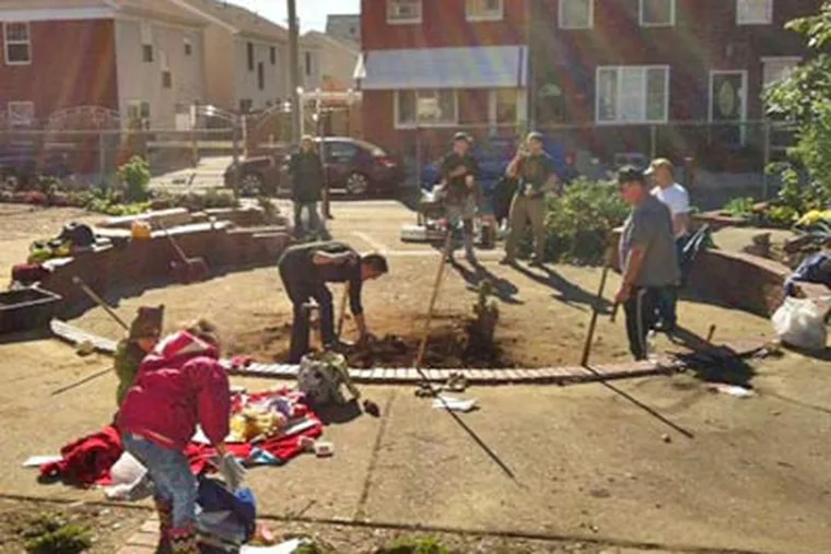Friends of Manton Street Park and Community Garden work to restore the South Philly pocket park earlier this year, unaware that the city was putting the parcel up for sale.