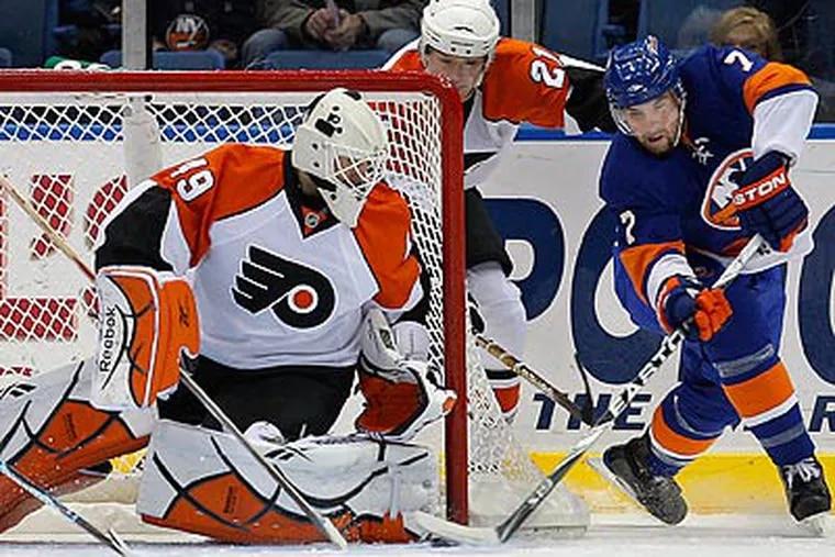 Flyers goaltender Michael Leighton made 28 saves against the Islanders. (Kathy Willens/AP)