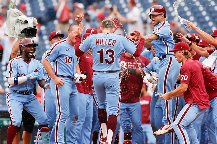 Phillies Brad Miller (center) celebrates his game winning walk off grand slam home run with his teammates against the Washington Nationals in game two of a doubleheader on Thursday, July 29, 2021 in Philadelphia.  The Phillies beat the Nationals 11-8.