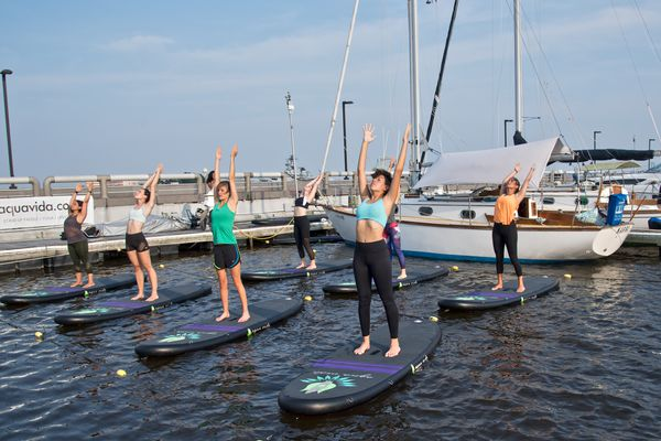 I tried, and enjoyed, Philly paddleboard yoga over the dirty Delaware River
