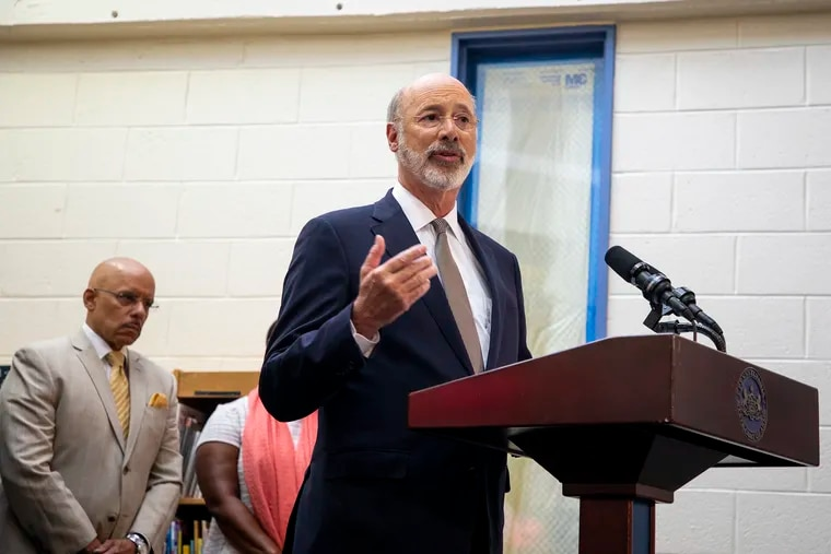 Gov. Tom Wolf is shown above at a news conference in July, where he announced more money for lead-paint abatement in Philadelphia Schools. On Tuesday, he discussed a plan for changes to state charter school regulations and law.