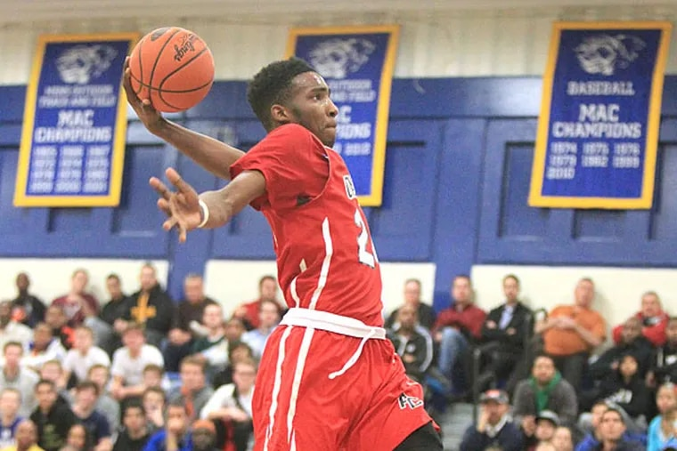 Derrick Jones of Archbishop Carroll goes up for a tomahawk dunk against the Haverford School in the 3rd quarter of boys' basketball at the Pete and Jameer Nelson Holiday Classic at Widener University on Dec. 30, 2014.  Jones led Carroll with 21 points.  (Charles Fox/Staff Photographer )