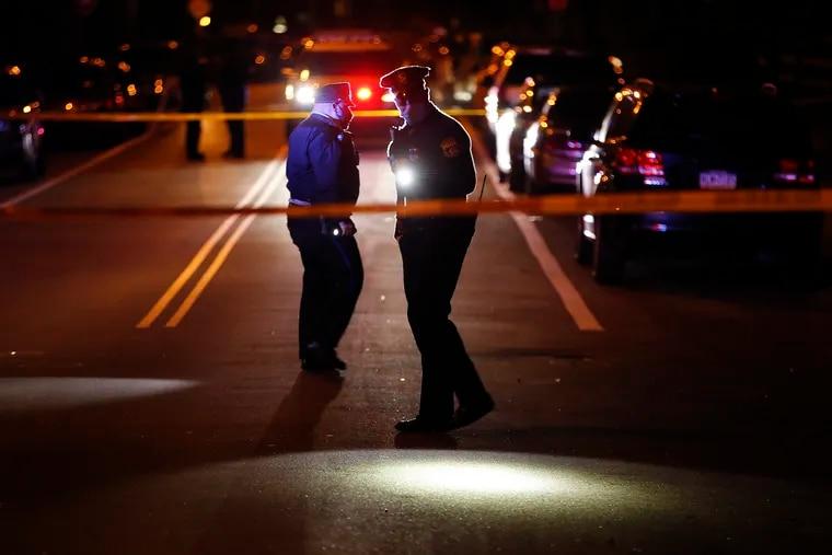 Philadelphia Police investigate a scene where a woman was shot in the arm along the 4100 block of Mantua Avenue in West Philadelphia on Saturday.