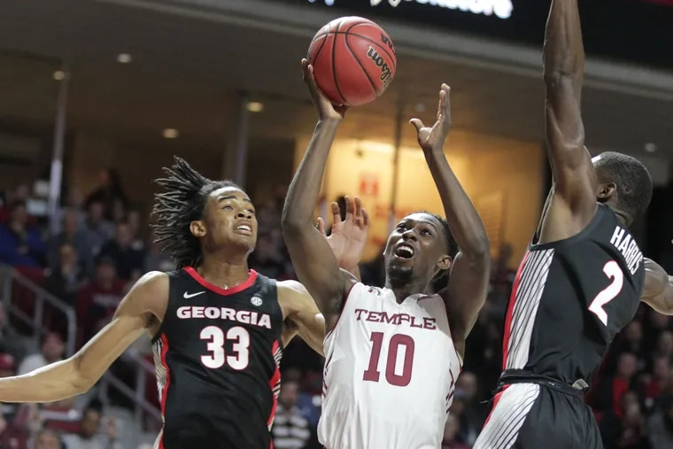 Shizz Alston, center, of Temple Nicolas Claxton, left, and Jordan Harris of Georgia as he goes up for a shot during the 1st half at the Liacouras Center on Nov. 13, 2018.