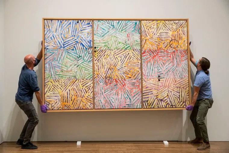 """Chris Havlish and Gus Boyce, from the installation and packing department, install """"Usuyuki,"""" 1982, by Jasper Johns on loan from Japan at the Philadelphia Museum of Art. The Jasper Johns: """"Mind/Mirror"""" retrospective opens on Sept. 29."""