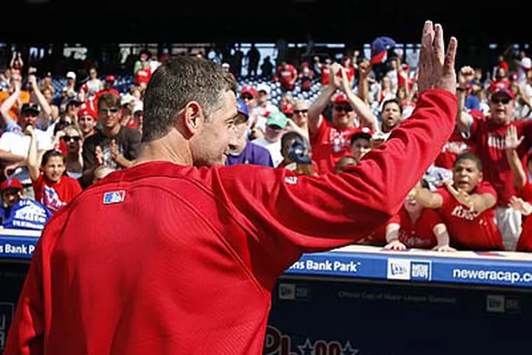 Jamie Moyer salutes the fans at Citizens Bank Park after recording his 250th career win. (David Maialetti/Staff Photographer)