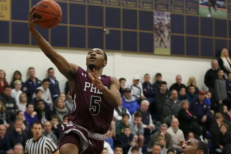 St. Joseph's Prep Darius Kinnel lays up the basketball in a recent game.