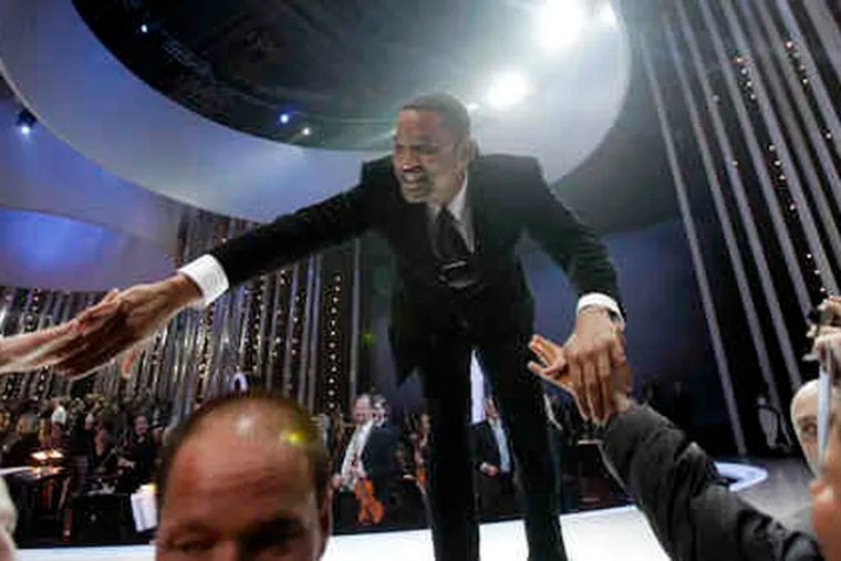Will Smith, a long way from West Philly, greets crowd members at the conclusion of the Nobel Peace concert in Oslo, Norway, on Dec. 11. Artists from all over the world gathered at the Oslo Spektrum to help celebrate this year's laureate, President Obama.