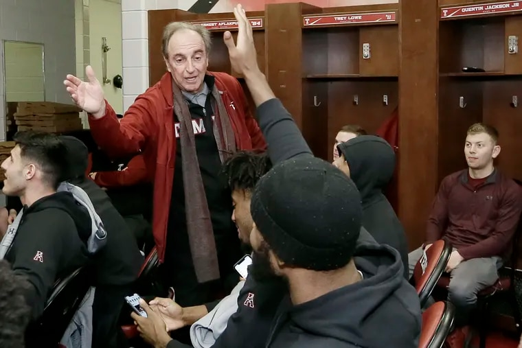 Temple head coach Fran Dunphy high-fives members of the Temple team shortly after learning they were being included in the NCAA Tournament.