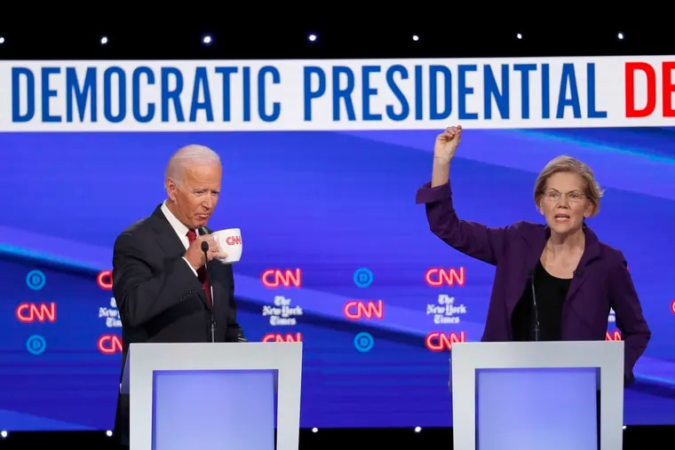 Former Vice President Joe Biden and Sen. Elizabeth Warren (D., Mass.) participate in a Democratic presidential primary debate hosted by CNN and The New York Times at Otterbein University, Tuesday in Westerville, Ohio.