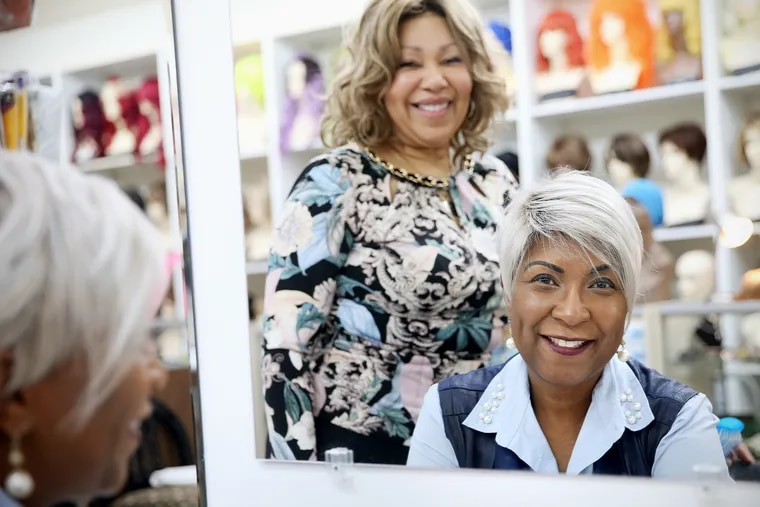 Hairs 2 U Wig Bank owner Lois Arnold, left, and client Glynis Rhodes, who is undergoing chemotherapy for the third time.