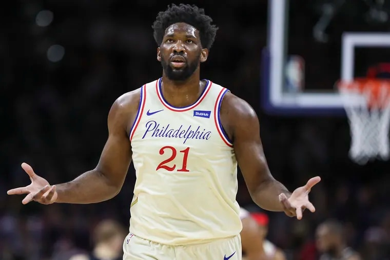 Sixers center Joel Embiid gestures after he hit a three-pointer in the first quarter against the Bucks.