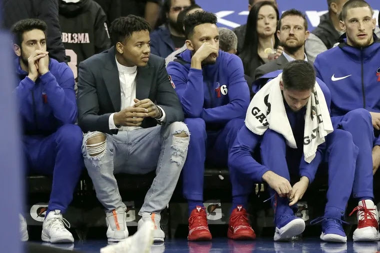 Sixers guard Markelle Fultz (ripped jeans) sits on the bench during the first quarter of Wednesday's game against New Orleans.