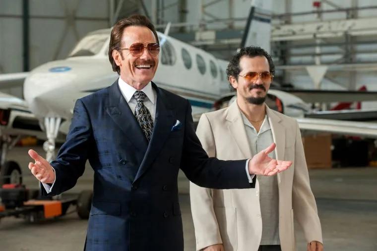 Bryan Cranston stars as undercover U.S. Customs agent Robert Mazur and John Leguizamo as his partner Emir Abreu in THE INFILTRATOR.