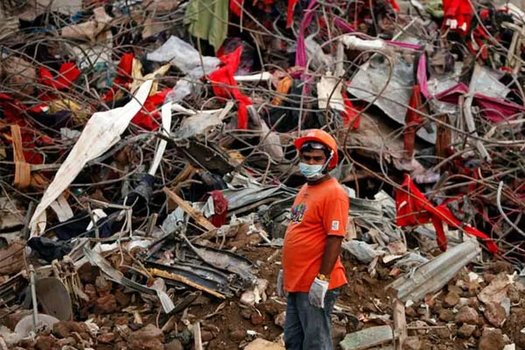 A rescue worker stands amid the rubble of a garment industry building that collapsed last month near Dhaka, Bangladesh, killing more than 1,100. (Associated Press)