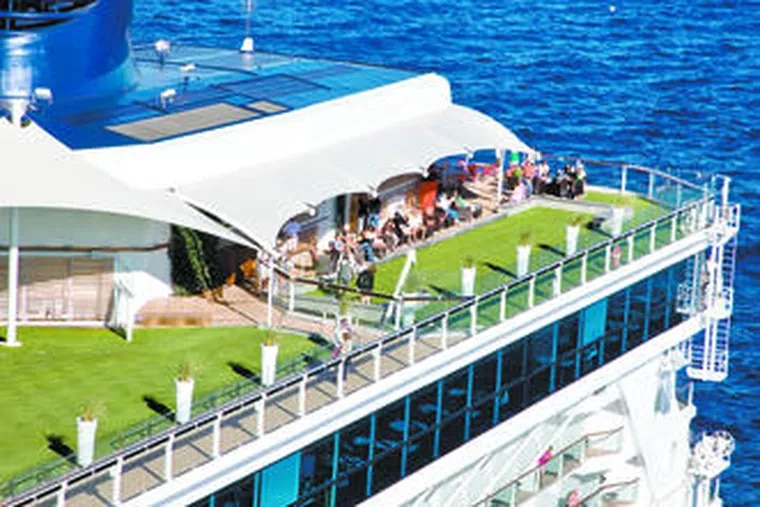 On Celebrity's new ship, Solstice, travelers enjoy the Lawn Club, a wide carpet of real grass, one of the ship's many stylish features.