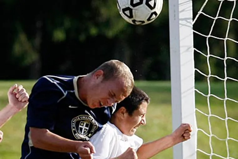 LaSalle College's Chris Pawlowski (left) and Landsdale's Alex Manzo go after a ball near Lasalle's goal. ( Michael S. Wirtz / Staff Photographer )