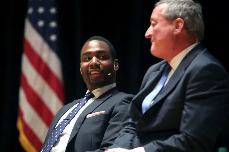 Doug Oliver smiles as Jim Kenney talks about Oliver at The Next Mayor debate at Temple University in Philadelphia on Monday, May 4, 2015. ( STEPHANIE AARONSON / Staff Photographer )