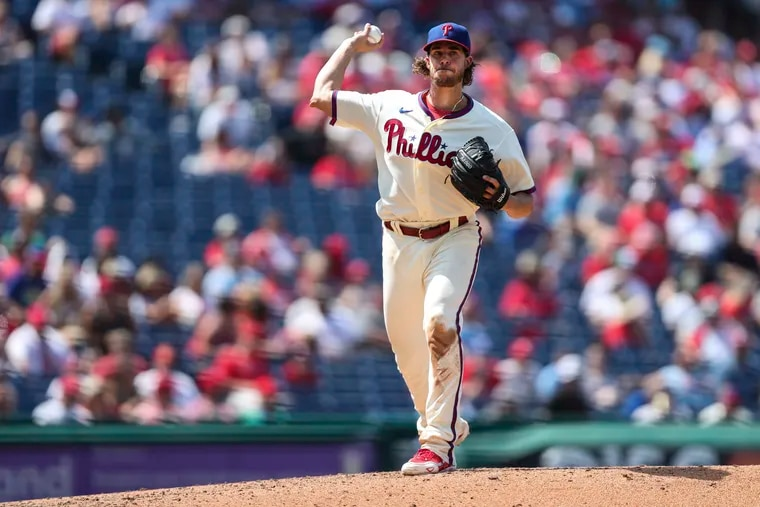 Philadelphia Phillies starting pitcher Aaron Nola (27) throws to first during the fifth inning of the Philadelphia Phillies game against the Cincinnati Reds at Citizens Bank Park in Philadelphia, Pa. on Sunday, August 15, 2021.