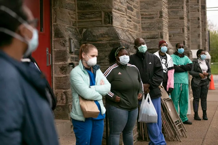 A group of volunteers consisting mostly of doctors and medical students gather for instructions before they run a coronavirus (COVID-19) testing site at the Miller Memorial Baptist Church in Philadelphia on Saturday, April 18, 2020. Dr. Ala Stanford procured a bunch of nasal swab kits and a van for this mobile testing site to help more African Americans get tested for the coronavirus.