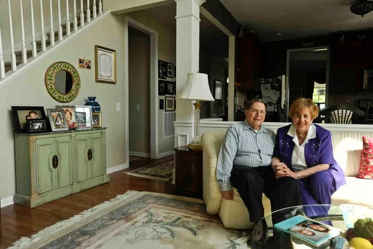 Peter and Anne Silverberg in the living room of their Delanco home. Each had years of possessions, but after marrying they were able to blend them with style. It helped that they have similar tastes.