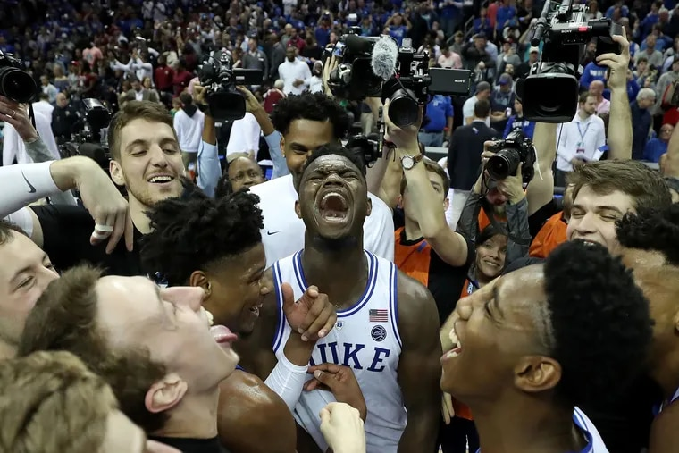 Duke's Zion Williamson (center) celebrates with his teammates after the Blue Devils beat Florida State in the ACC Tournament title game on Saturday.