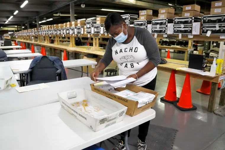 Tamara Debnam, an elections assistant for the Baltimore City Board of Elections, sorts mail-in ballots at a canvasing warehouse earlier this week.