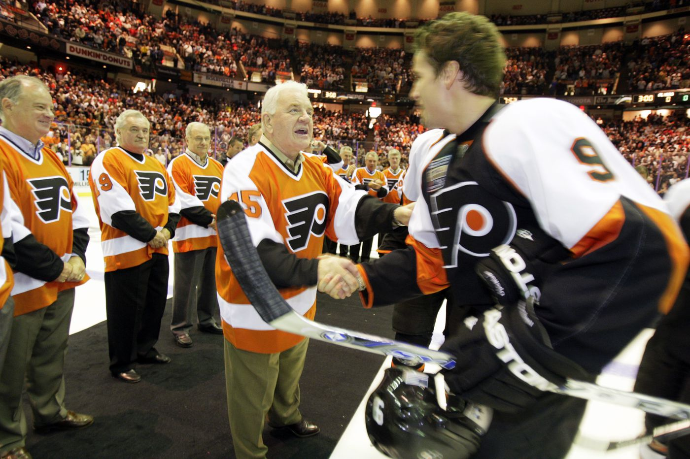 Can you identify the Flyers fan who joined the handshake line after 1974 Cup clincher? A reward awaits.