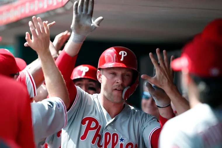 Rhys Hoskins  is congratulated in the dugout after hitting a two-run homer in the third inning of Monday's win against Cincinnati.