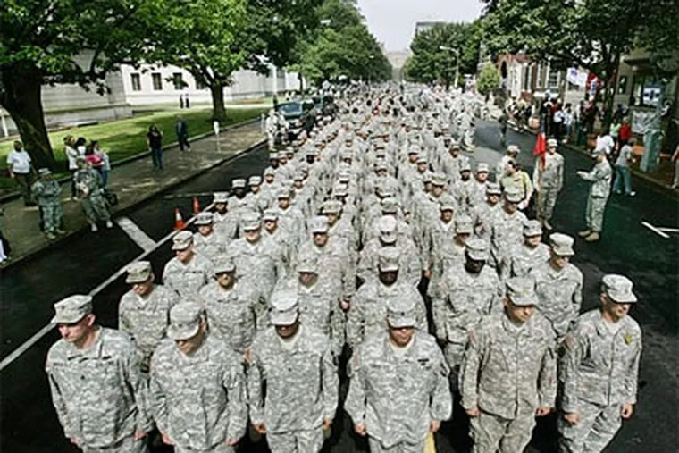Hundreds of New Jersey National Guard soldiers fill the street to march  through downtown Trenton. (Mel Evans / Associated Press)