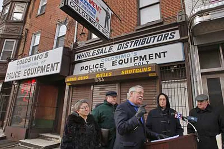 Members of the city's religious community hold a press conference in front of Colosimo's gun center in January.  (Michael S. Wirtz / Staff Photographer)
