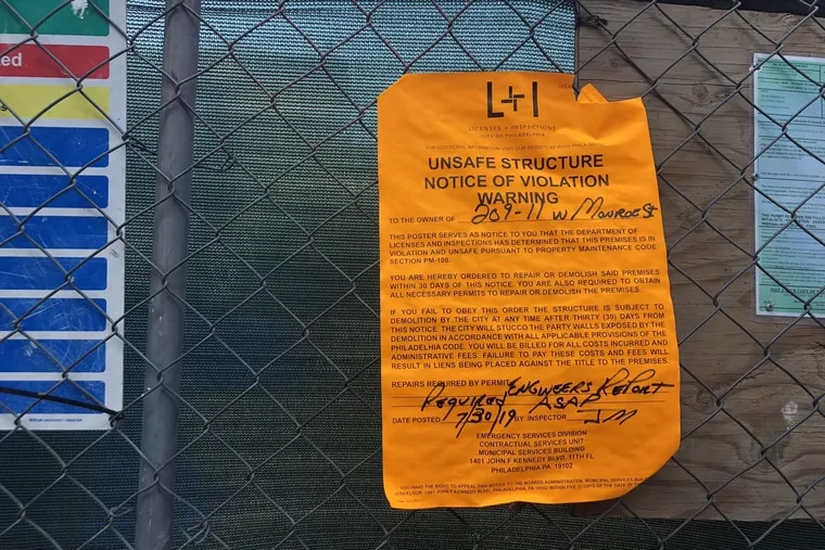 A violation notice posted by the Department of Licenses and Inspections at the Monroe Street condo project in Queen Village.