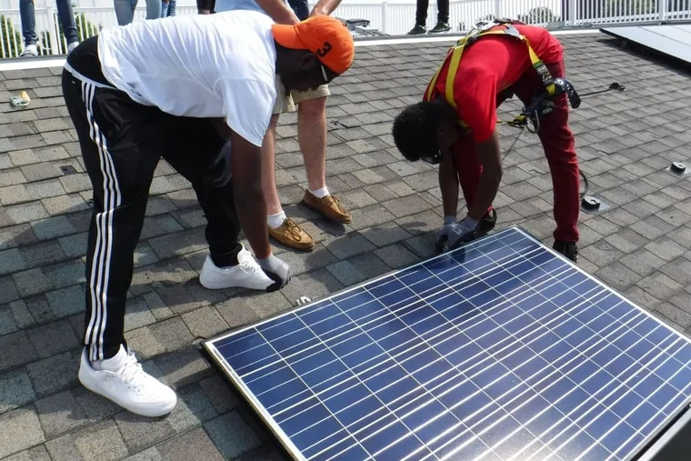 Students from the Philadelphia School District's first solar training program  learn installation at the Navy Yard.