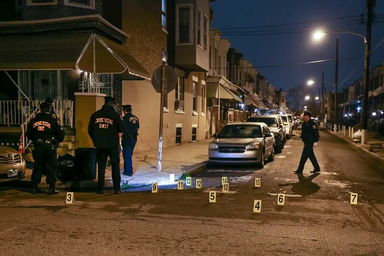 The Philadelphia Police Crime Scene Unit work the 2300 Block of West Harold Street, where five people were shot with more than 20 rounds fired during a late gathering Monday night. Tuesday, March 31, 2020.