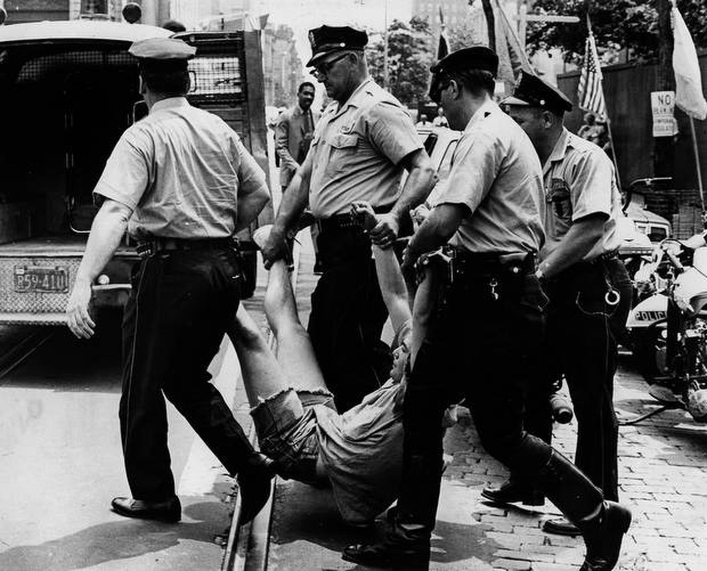 Philadelphia Police carry a protester away from a July 4, 1966 anti-Vietnam War protest held at Independence Hall. A new study proves police are twice as likely to break up a left-wing demonstration than a right-wing one, like Wednesday's storming of the U.S. Capitol.