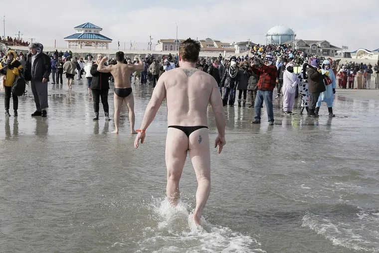 Participants run in and out of the ocean during the 22nd annual Polar Bear Plunge in Sea Isle City on Feb. 13, 2016. Ventor is cancelling its New Year's Day plunge over concerns about the deep freeze gripping the region.