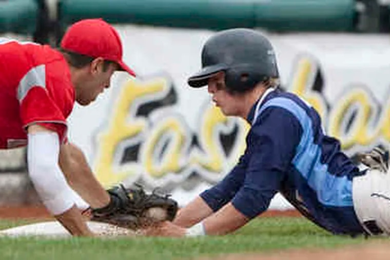 North Penn's Robbie Zinsmeister is safe at third ahead of the tag by Parkland's Mike Miorelli in the third inning. The Knights scored twice in the fifth and once in the seventh to seal the victory.
