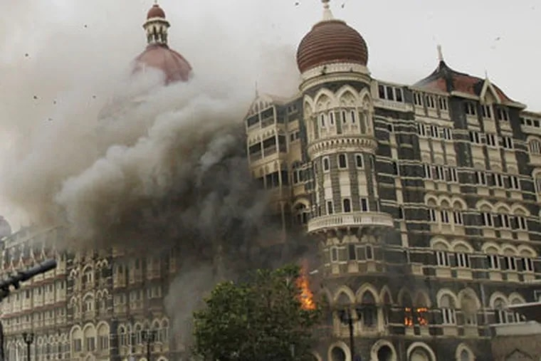 The Taj Mahal hotel burns during gun battle between Indian military and militants inside the hotel in Mumbai, India, Saturday, Nov. 29, 2008. It brought to end more than three days of terror that began with a bombing. (AP Photo/David Guttenfelder)