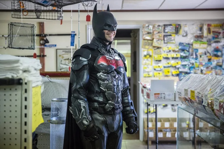 Bob Gable dressed up as the Bucks County Batman in Ed's Bait and Tackle Shop in Bensalem, where he gained social media fame when a video of him cleaning up graffiti for the store went viral.