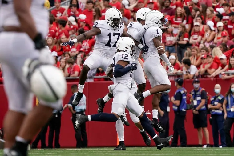 Penn State's Jaquan Brisker celebrates his late interception in the victory at Wisconsin.