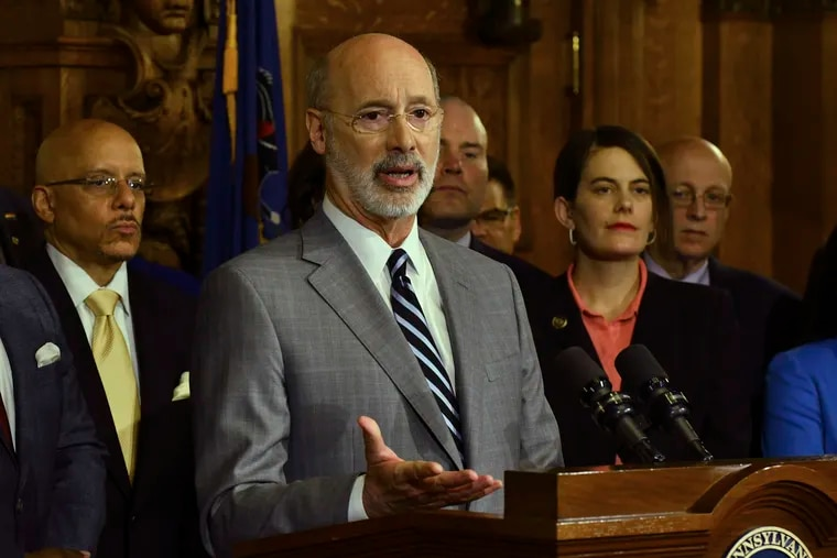 Gov. Tom Wolf speaks at a news conference in his Capitol offices as he unveils a $1.1 billion package intended to help eliminate lead and asbestos contamination in Pennsylvania's schools, homes, day care facilities and public water systems, Wednesday, Jan. 29, 2020 in Harrisburg, Pa. Looking on are Democratic state lawmakers and officials from teachers' unions. (AP Photo/Marc Levy)