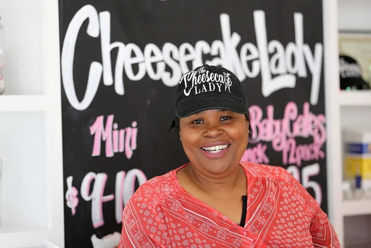 Vanessa Jackson, owner of Cheesecake Lady, a cheesecake-dedicated bakery, poses for a portrait in her shop in Elkins Park.