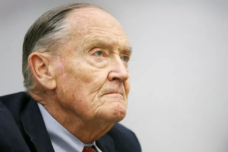In this May 20, 2008, file photo John Bogle listens during an interview at The Associated Press in New York. The surge in popularity for index funds is a product of their lower fees, better performance and the preaching of Bogle, the founder of Vanguard Group, which launched the first index mutual fund for individual investors in 1976. Bogle died Jan. 16, 2019, at 89 after pushing for years to keep costs down and widen access to index funds. (AP Photo/Mark Lennihan, File)