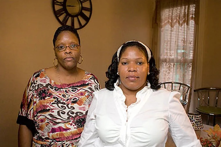 What their brother Martin did was wrong - but he's not a monster, say his sisters Paula Millington and Tracy Smith of Martin Smith, the man who is accused of taking a watch from the wrist of Joaquin Rivera as he lay dead in a hospital waiting room. (Ed Hille / Staff Photographer)