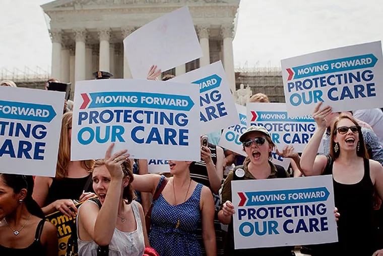 Demonstrators in favor of the Affordable Care Act hold up signs outside the Supreme Court building after the court's ruling in Washington, D.C., U.S., on Thursday, June 28, 2012. The U.S. Supreme Court upheld the core of President Barack Obama's health-care overhaul, giving him an election-year triumph and preserving most of a law that would expand insurance to millions of people and transform an industry that makes up 18 percent of the nation's economy. (Andrew Harrer/Bloomberg)