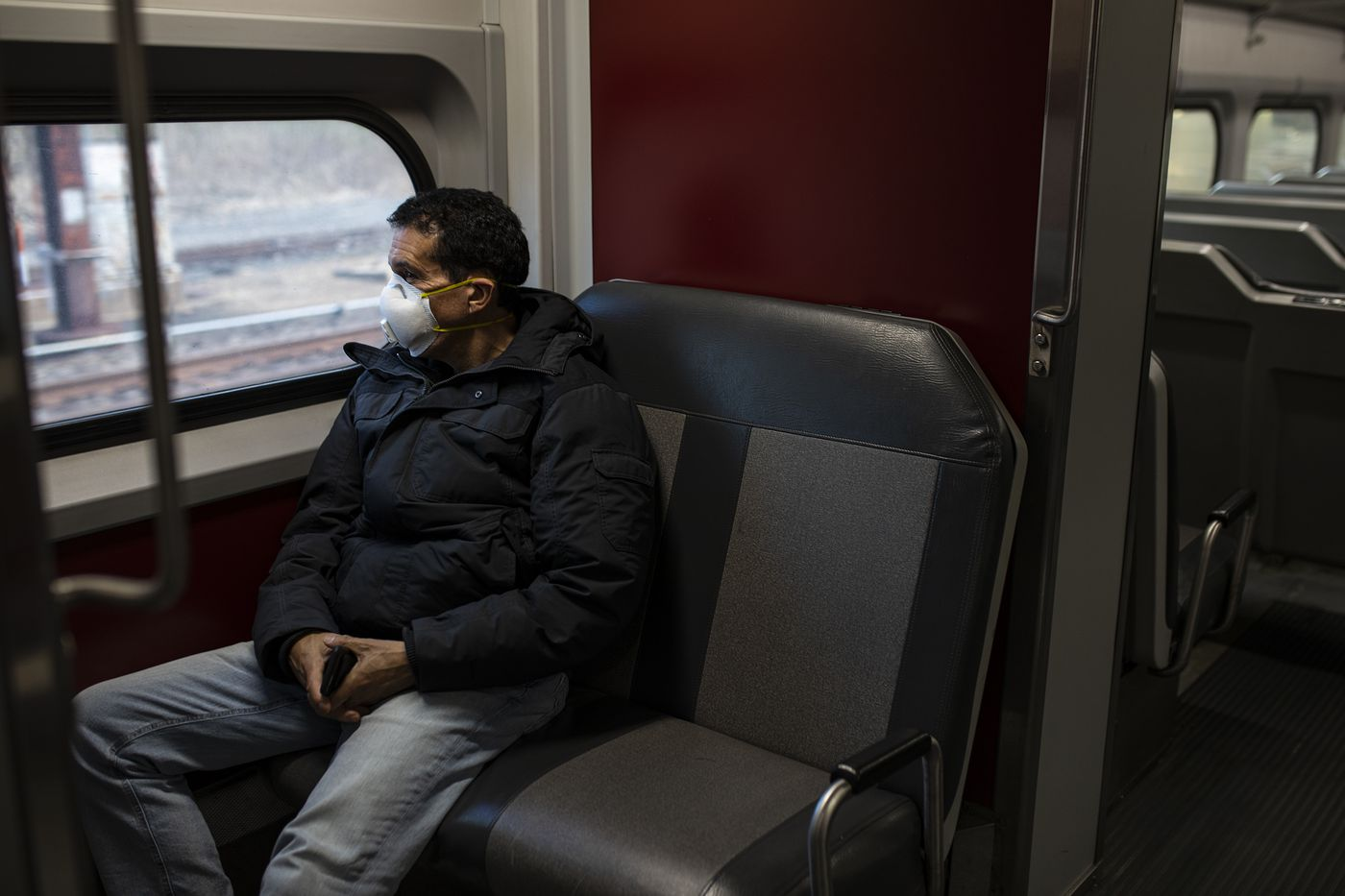 """Rick Kane, of Devon, Pa., rides on the Regional Rail line towards Center City for work on Tuesday, March 24, 2020. Kane has been traveling on train for almost 10 years and stated that he has never seen anything like this before. """"I don't feel anything, just ride it out and hope for the best,"""" Kane said. """"Doing what the officials are asking me to do. I just miss everything and want to go back to normal."""""""