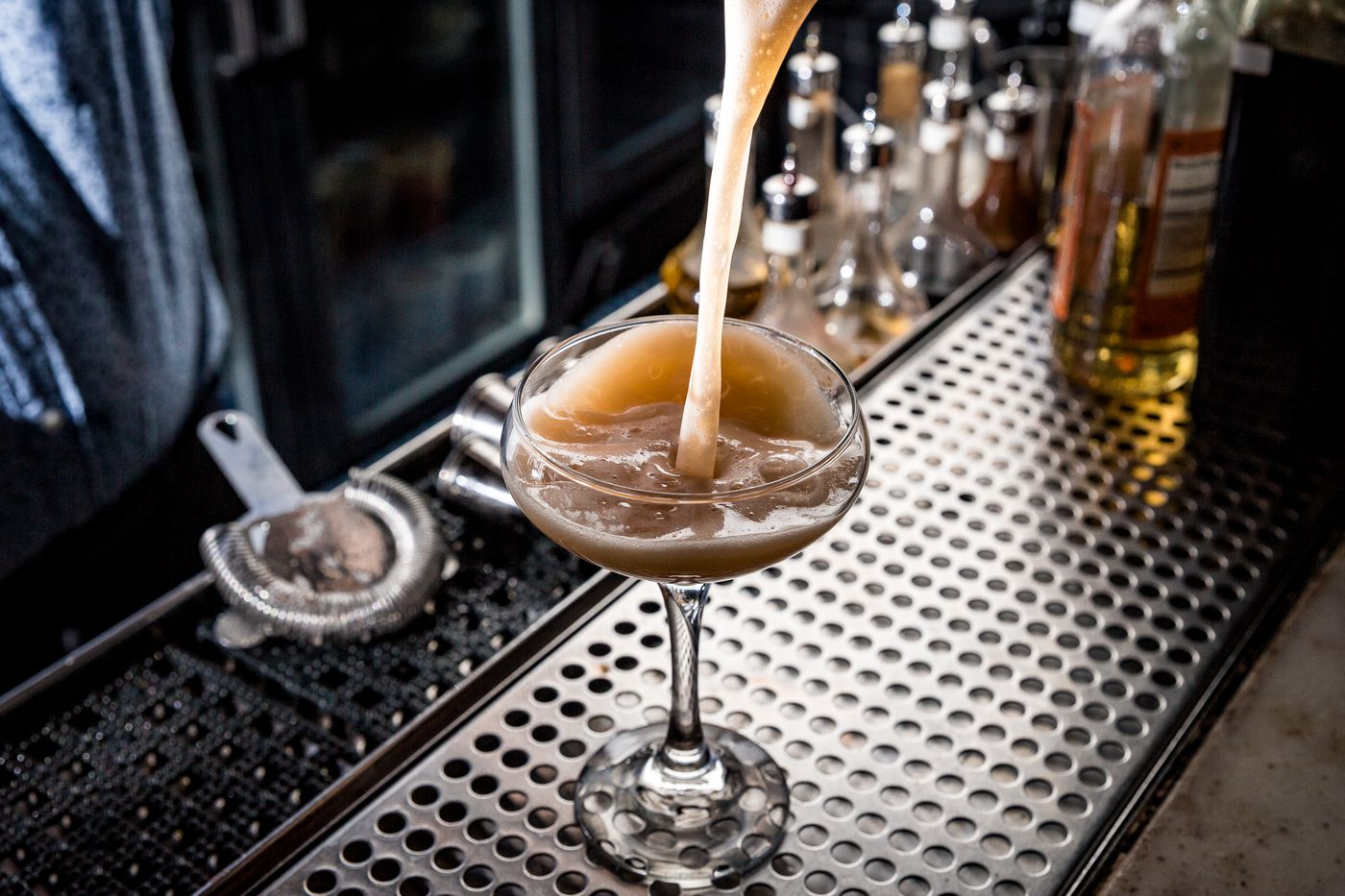 """Franklin Bar's Miranda Helck wanted to create an """"umami bomb"""" with the Amorous Men are Gullible, composed of shiitake-infused blended scotch, yellow chartreuse, dashi, lemon, celery bitters, togarishi, and egg white."""